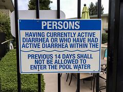 Sign at pool