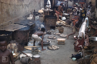 Smoking small fish on braziers. Accra Fishing quarters