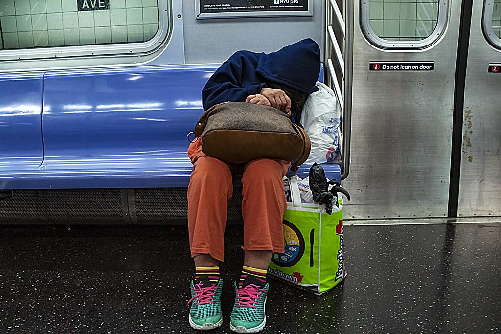 Sleeper on E Train--Manhattan