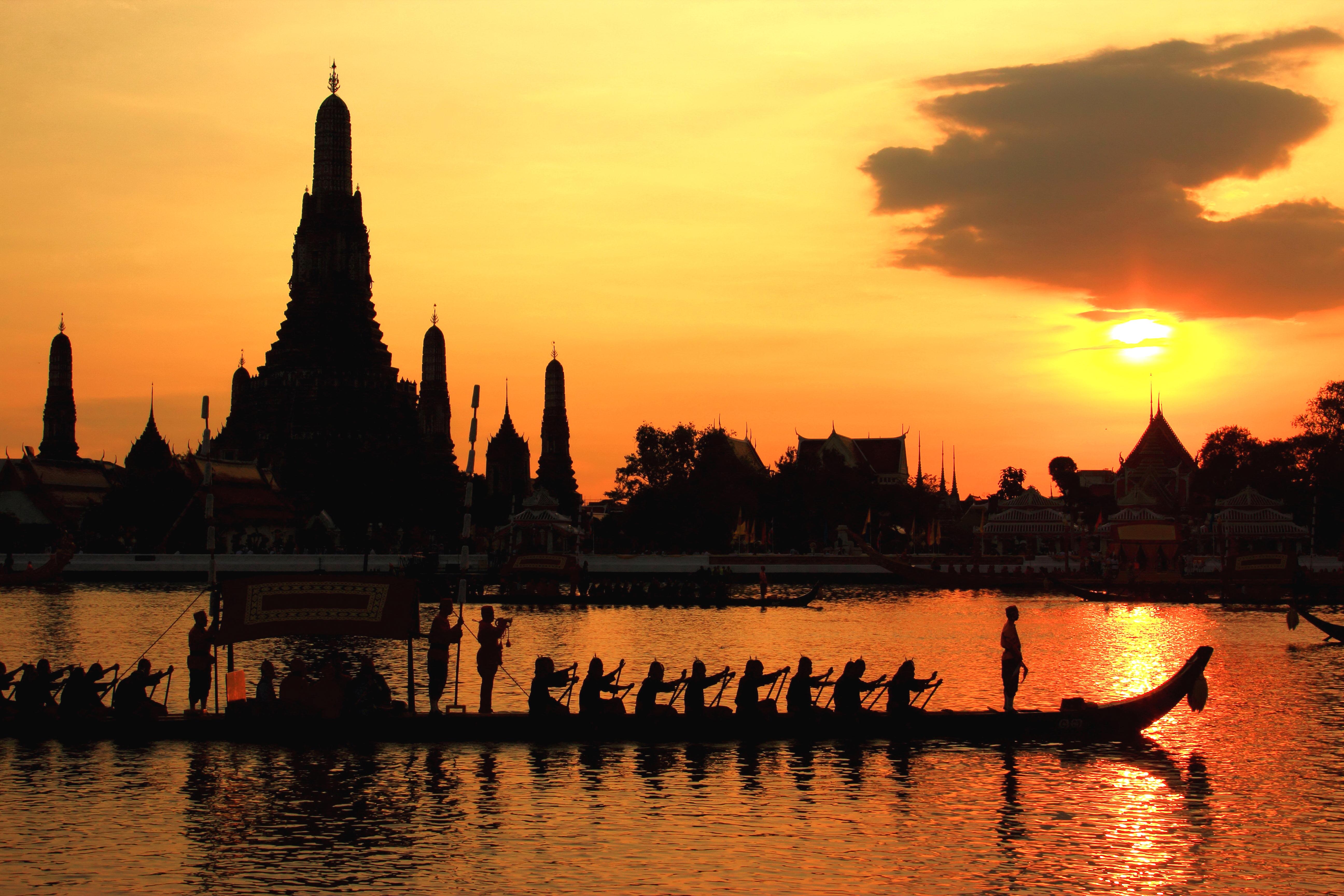 The Royal Barge Procession passes Wat Arun Ratchawararam on November 9, 2012.