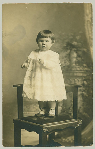 RPPC small boy and chair