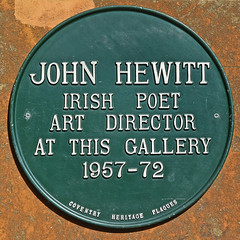 Photo of John Hewitt black plaque