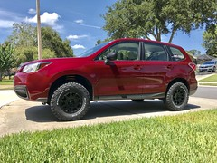Lifted 2016 Subaru Forester with Method Race Wheels and BFG All-Terrain tires