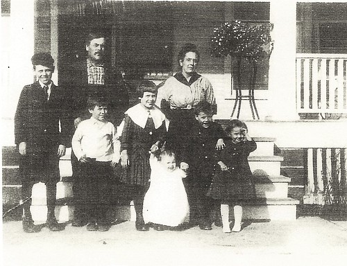 Casbon George and family in front of house