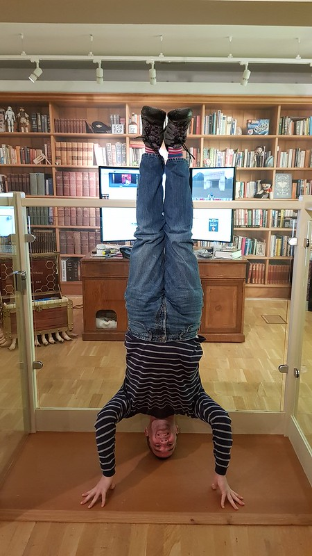 80. terry prachett's office headstand