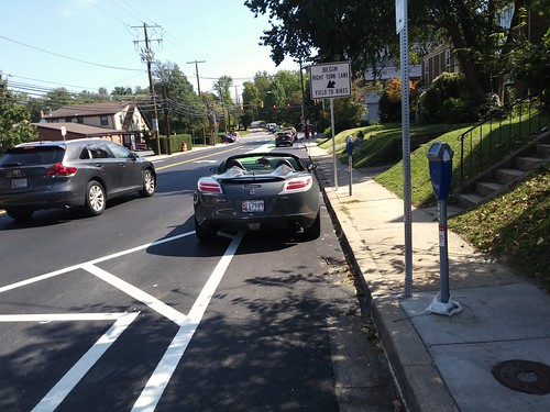 Car parked in the new new cycletrack on Cedar Street, Silver Spring, Maryland