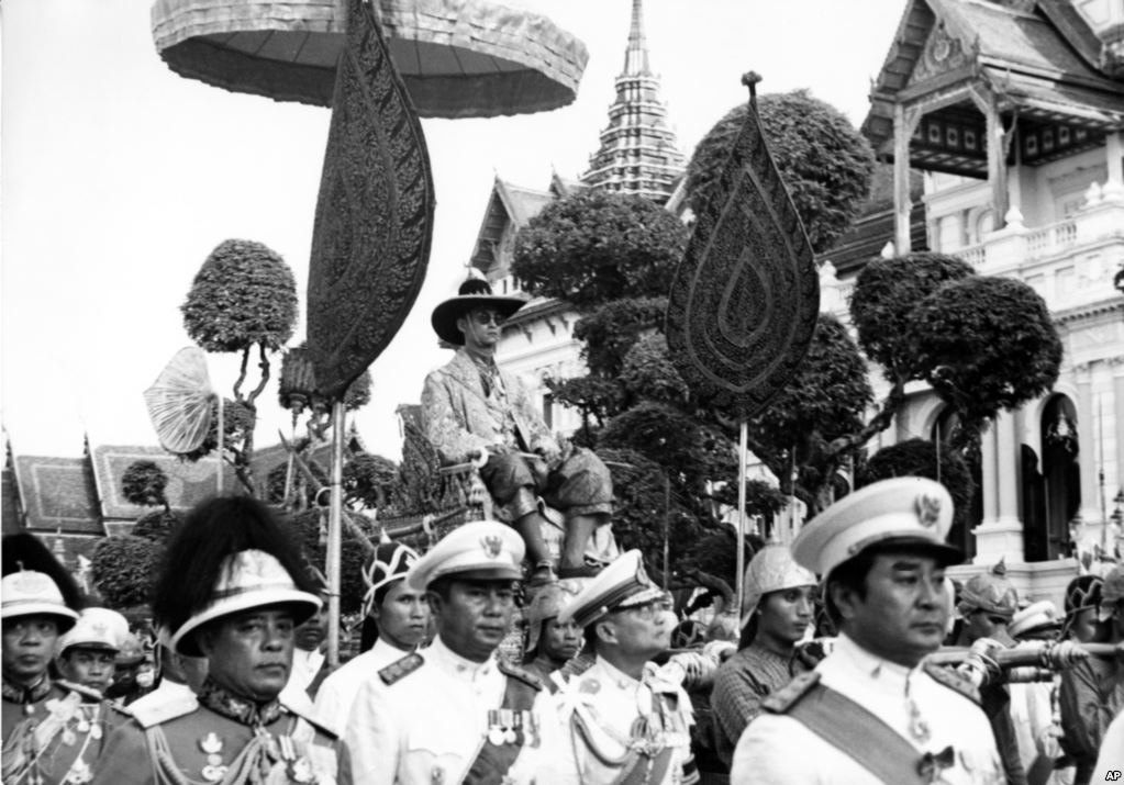 King Bhumibol Adulyadej is carried on the shoulders of Royal guards during a parade in Bangkok on December 7, 1963. The parade climaxed one week-long celebration of the King's 36th birthday.