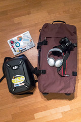 Digital Nomad with MacBook, DJI Drone, DSLR and Noise Cancellation