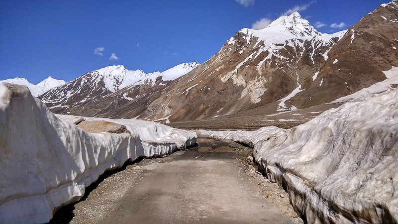 Road carved through snow and decorated with deceptive potholes all the way