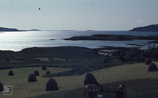 View over haycock from north side of Loch Tuath west to Lunga and Fladda peneplain wave cut. August 1968