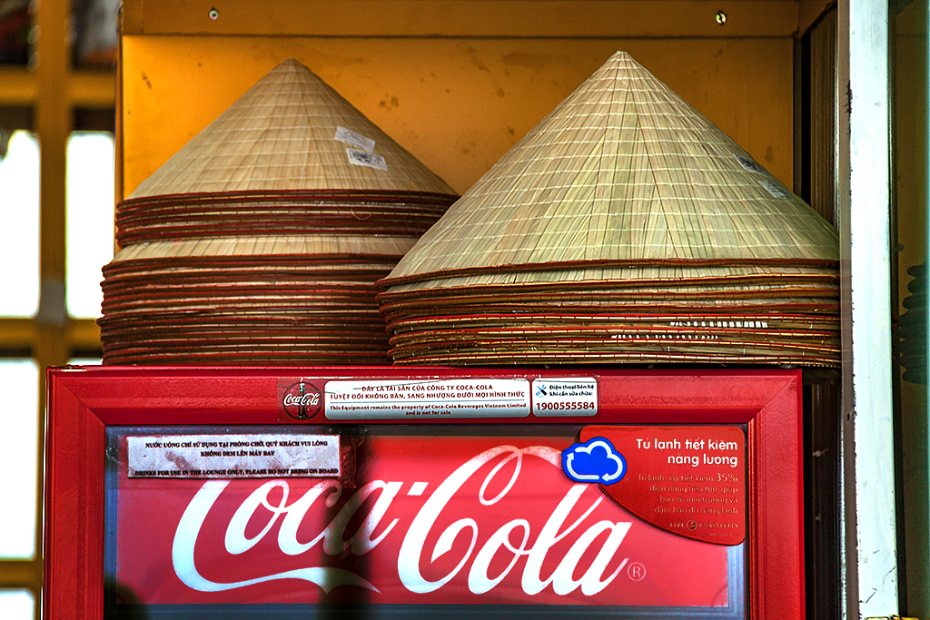Conical hats and Coca Cola--Hanoi