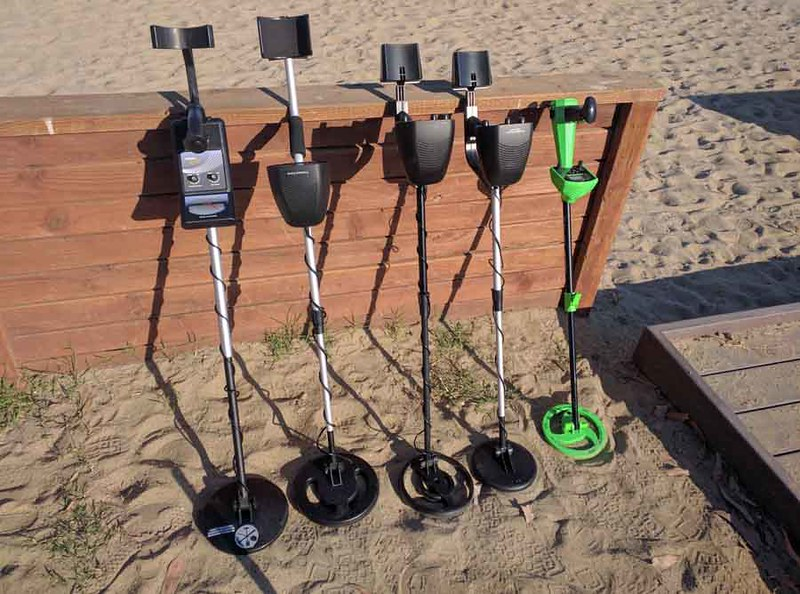 Metal detectors lined up at the beach w/ kids size