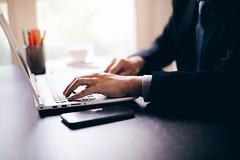 Business man hands on-a laptop keyboard, technology internet work