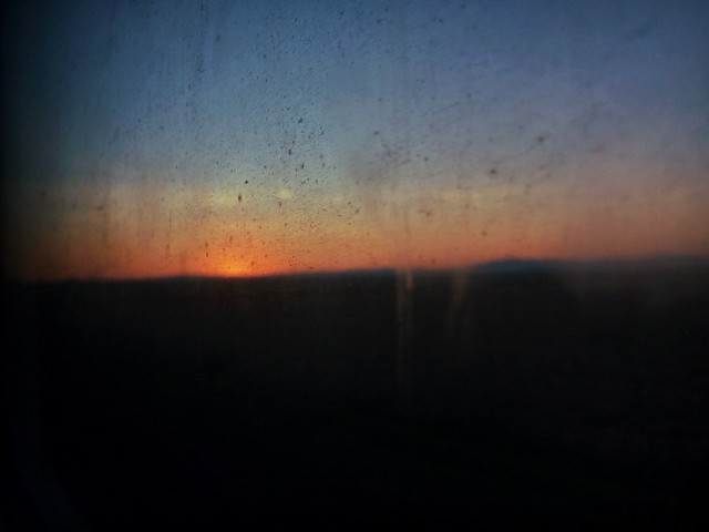 Sunset through dirty window