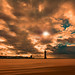 Storm Brewing over Lighthouse by John Tymon