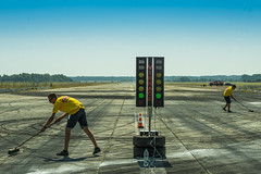 Employees of the Federation of Automobile Sports  prepare the track