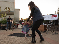 Insight host Beth Ruyak takes a dancing break during a performance by the Christian DeWild Band.