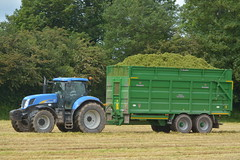 New Holland T7050 Tractor with a Broughan Engineering Mega HiSpeed Trailer