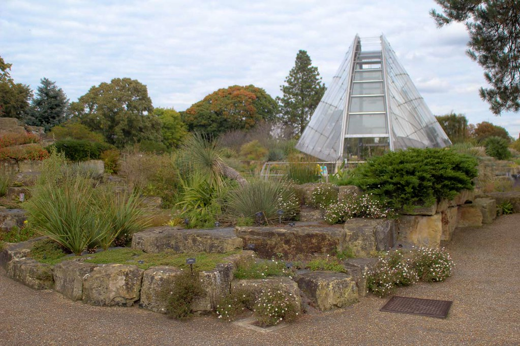 Davies Alpine House at Kew Gardens, London, with a rocky garden in front of it