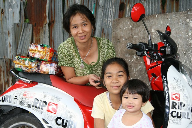 pretty ladies, dried noodles and a motorcycle