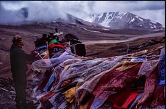 Yeshi hangs a prayer flag. Altitude 5500m