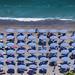 Aerial view of the amazing beach with colorful umbrellas and people who sunbathe-motoros redőnyök