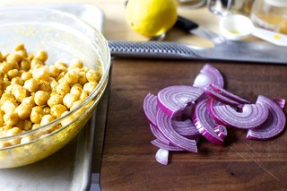 toss the spiced chickpeas with half of onion slices