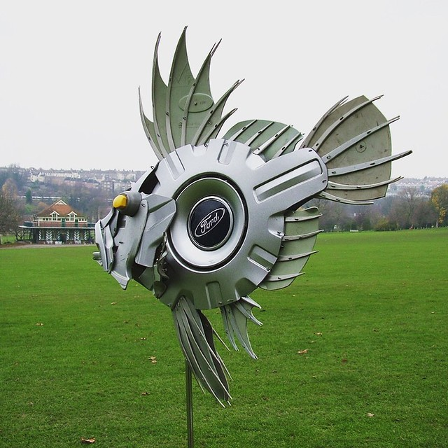 Here's a hubcap fish enjoying a swim in the park #fish #fishing #angling #johndory #recycled #upcycled #reclaimed #sculpture #art #hubcapcreatures