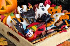 Pile of halloween cookies in wooden basket