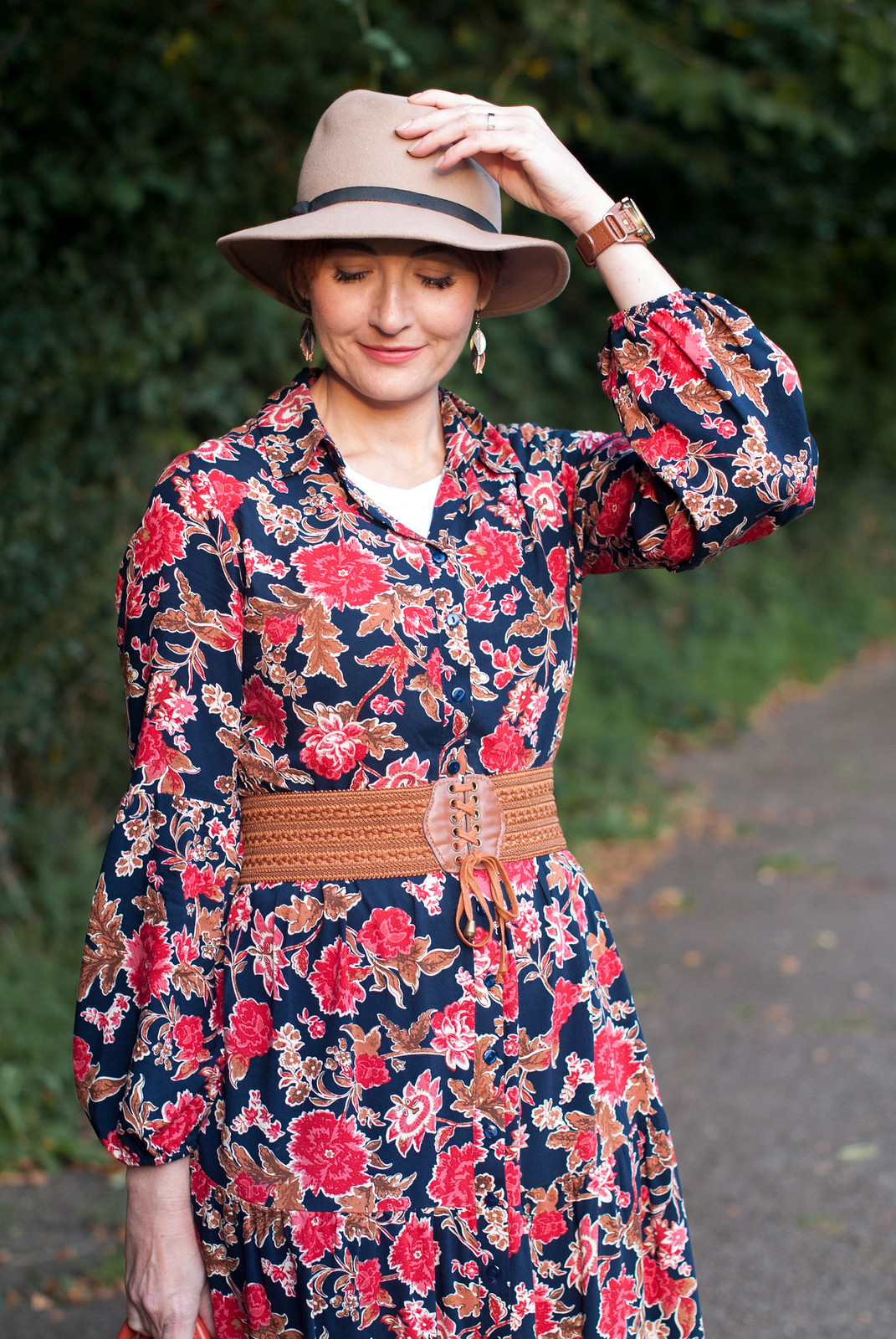 Romantic, Ralph Lauren-inspired 70s style autumn/fall outfit: Floral maxi dress \ tan belt and boots \ camel fedora \ orange leather tote bag | Not Dressed As Lamb, over 40 style