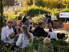 Capital Public Radio members and fans watch the Christian DeWild Band perform in the CapRadio Garden.
