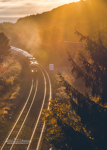 ns ns51v nspittsburghline norfolksouthern sunrise autumn fall glint railroad trains gallitzin pennsylvania unitedstates us