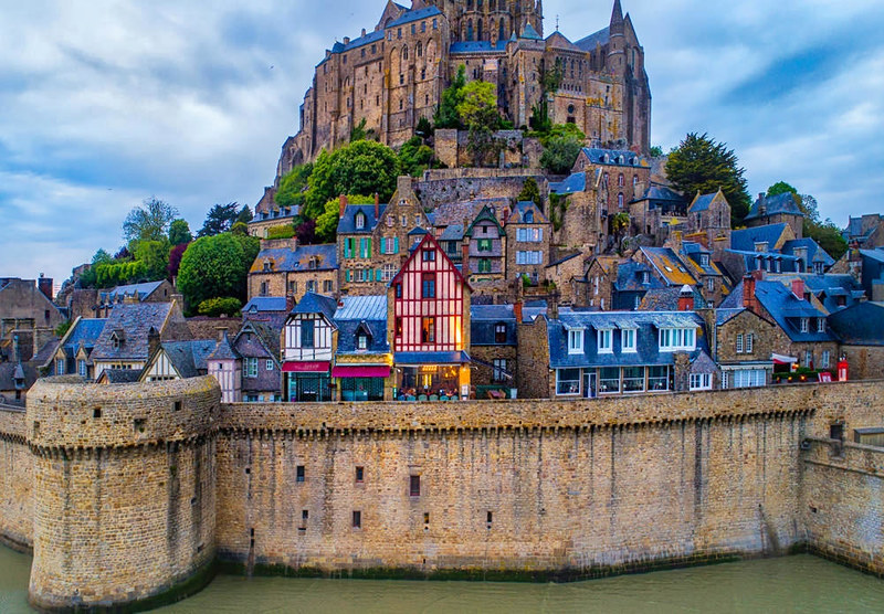 One of the charming little restaurants in Mont St Michel. Credit Trey Ratcliff, flickr