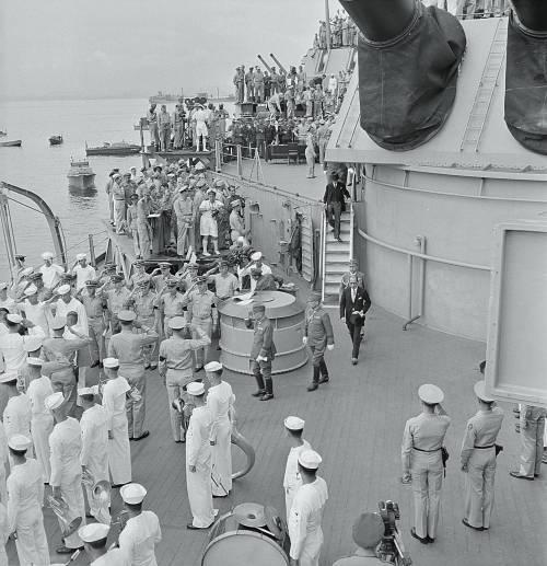 Japanese envoys leave the USS Missouri in Tokyo Bay, Japan, after signing surrender papers, 2 September 1945