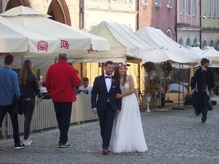 Olsztyn square - married couple promenading