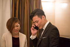 Japanese business people talking over the phone