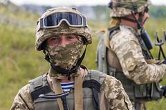 Ukrainian commando   rests  after training fight