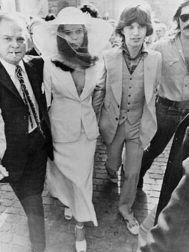 Wedding Dresses : Bianca Jagger's white YSL Le Smoking Jacket with accompanying skirt and over...