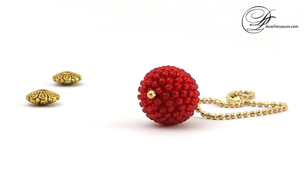 Bright red beaded bead charm on gold ball chain