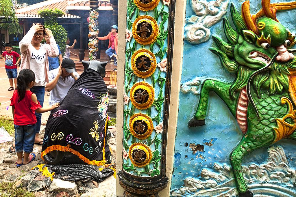 Rubbing the statue of the sacred black tiger--La Gi