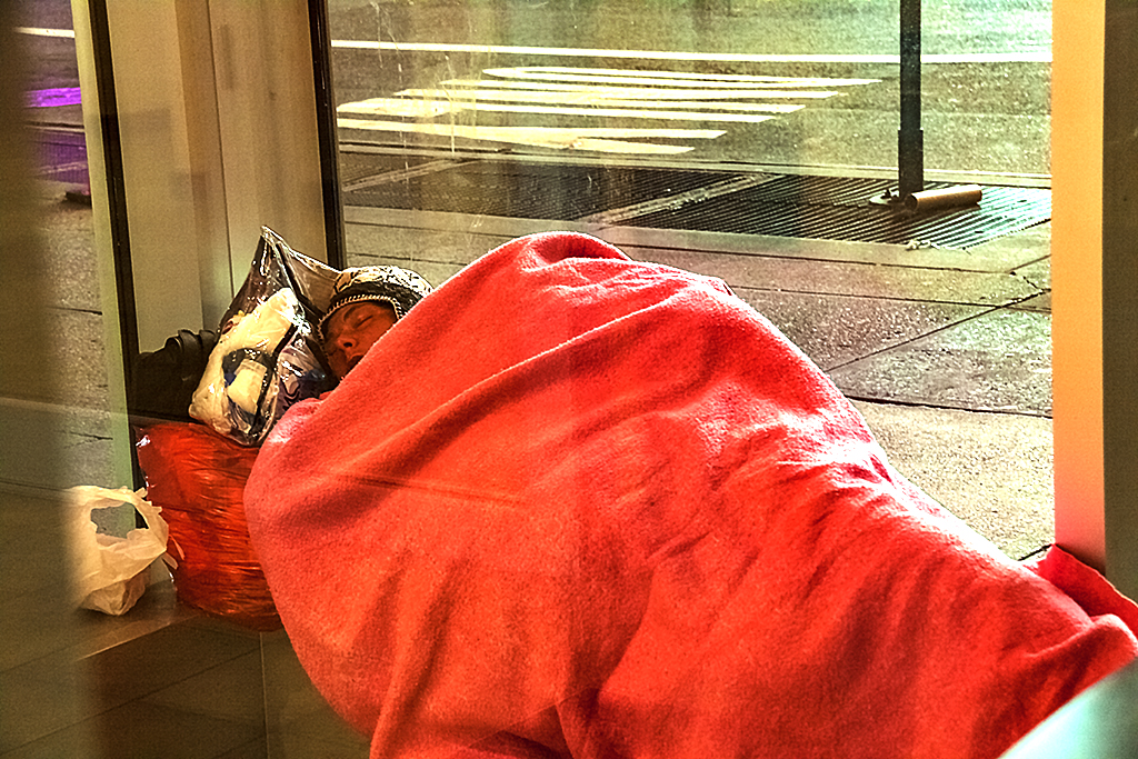 Woman sleeping inside Bank of America ATM terminal--Manhattan