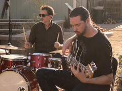 """Drummer Mike Pavisch and bassist Stephen Coronado performing """"Season Of The Witch"""" in the Cap Radio Garden."""