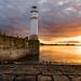 Sunset Sky Over Newhaven Lighthouse by Uillihans Dias