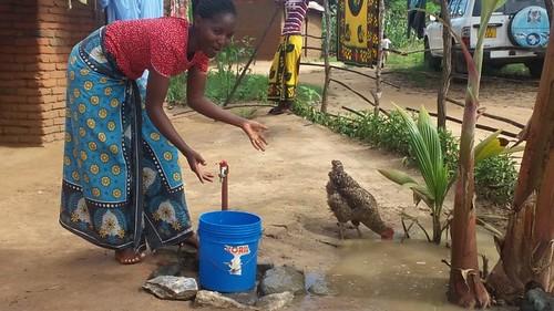 Sanula shows off her water tap (photo credit: ILRI)