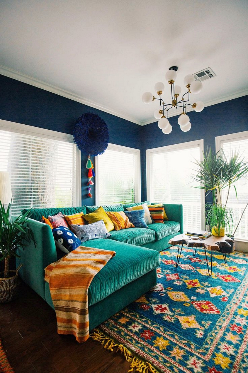 Bohemian Living Room Bright Teal Suede Couch Navy Wall Paint Colorful Rug