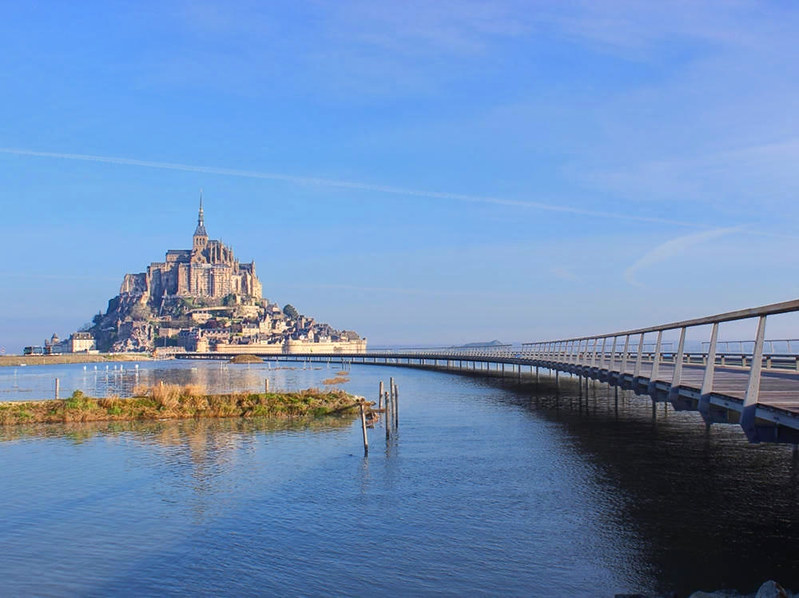 Mont Saint-Michel and its new light bridge at high tide. Credit Mathias Neveling