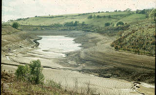 View down to dam. Lower Lliw Reservoir north of Swansea. Very low. May 1974