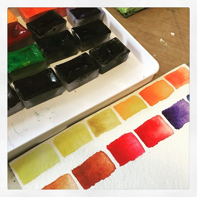 I swear I was going to clean up. But i found this set of watercolors that needed to be swatched and moved to a different tin... #danitaart #watercolors #watercolorswatches #artistlife
