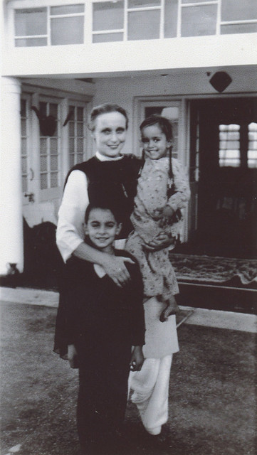 """1950. The first appearance of Freda's daughter Gulhima, """"Rose of the Snows,"""" born in Kashmir on September 15, 1949. Pictured with her brother Kabir, in front of their more conventional house. (Bedi family archives.)"""