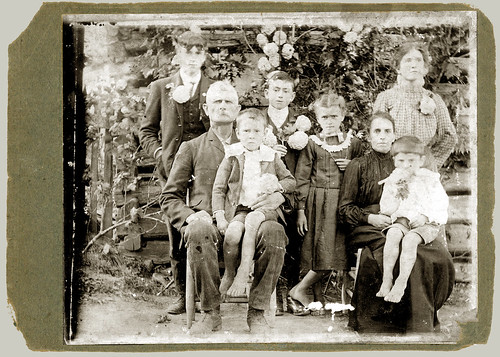 Card mounted photograph of family